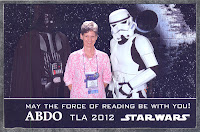 photo of Darth Vader, woman in pink shirt, Storm Trooper