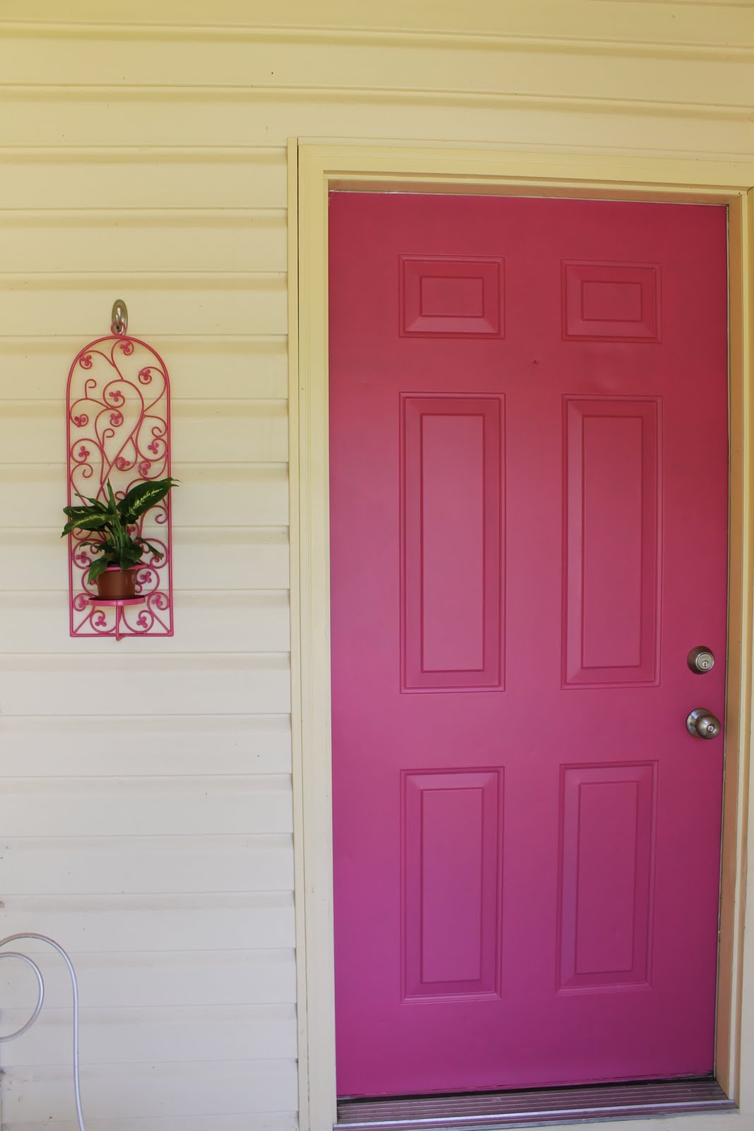 It is pretty hard to see from the road in these pictures but in real life the porch is less dark. The door is the same color as the middle circle on ... & Hems and Haws: Pink Door