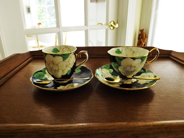 Frontal View Of Demite Coffee Cup To The Left And Tea Right