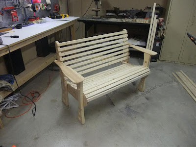 assembled wood bench, similar to adarondack chair