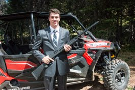 Two of Brad's favorite things; the RZR and Guns!