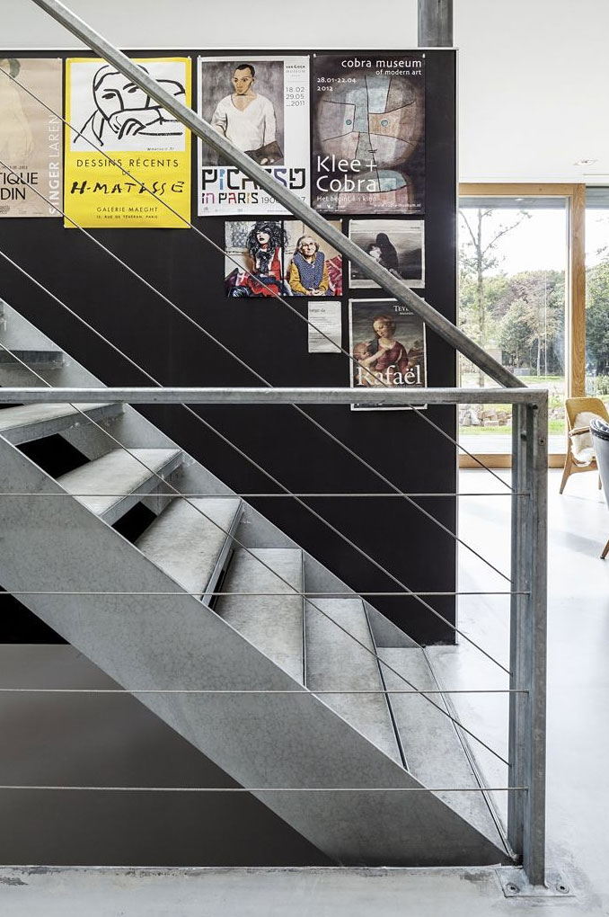 Steel stairs in Modern Villa V by Paul de Ruiter Architects