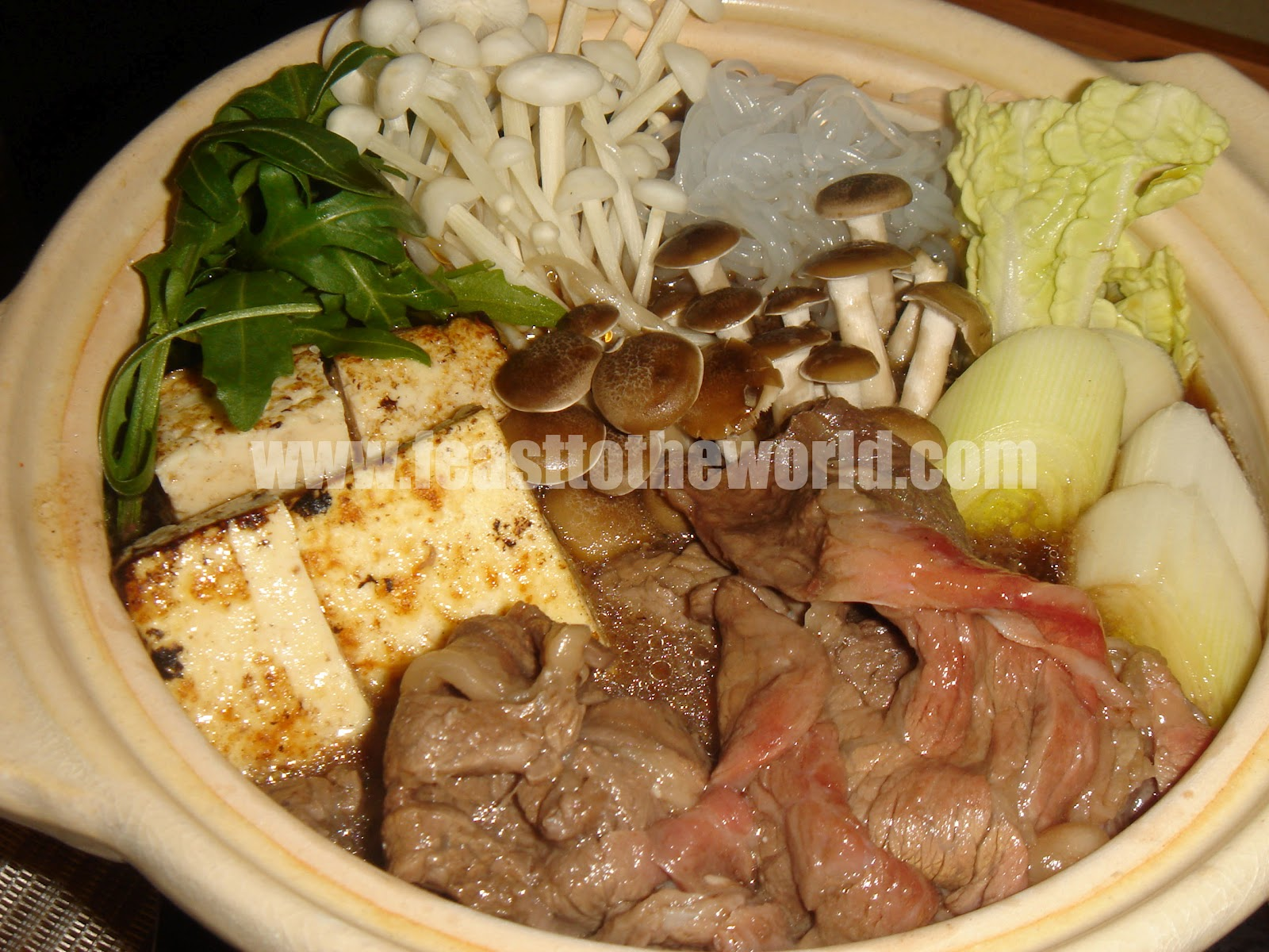 japanese beef hotpot sukiyaki すき焼き dip the cooked beef into
