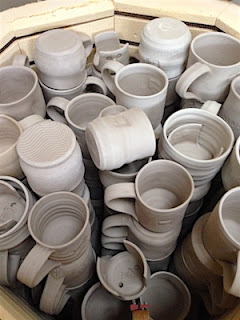 Bisque kiln full of Penland Auction Mugs by Lori Buff