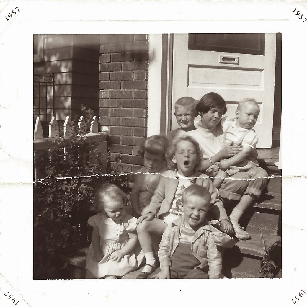 Image: Seven children sitting on the front stoop, by Catherine McDiarmid-Watt