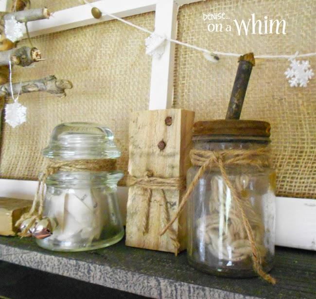An Insulator, a Block and a Glass Jar as Snowman Decor from Denise on a Whim