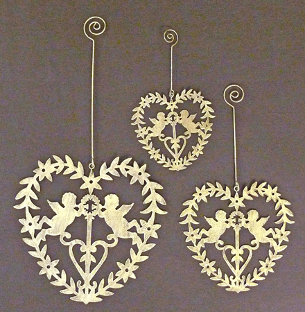here are my current top 10 ideas for christmas decorations starting with this wooden hanging dove set from carol ridler at daisy park - Chic Christmas Decorations