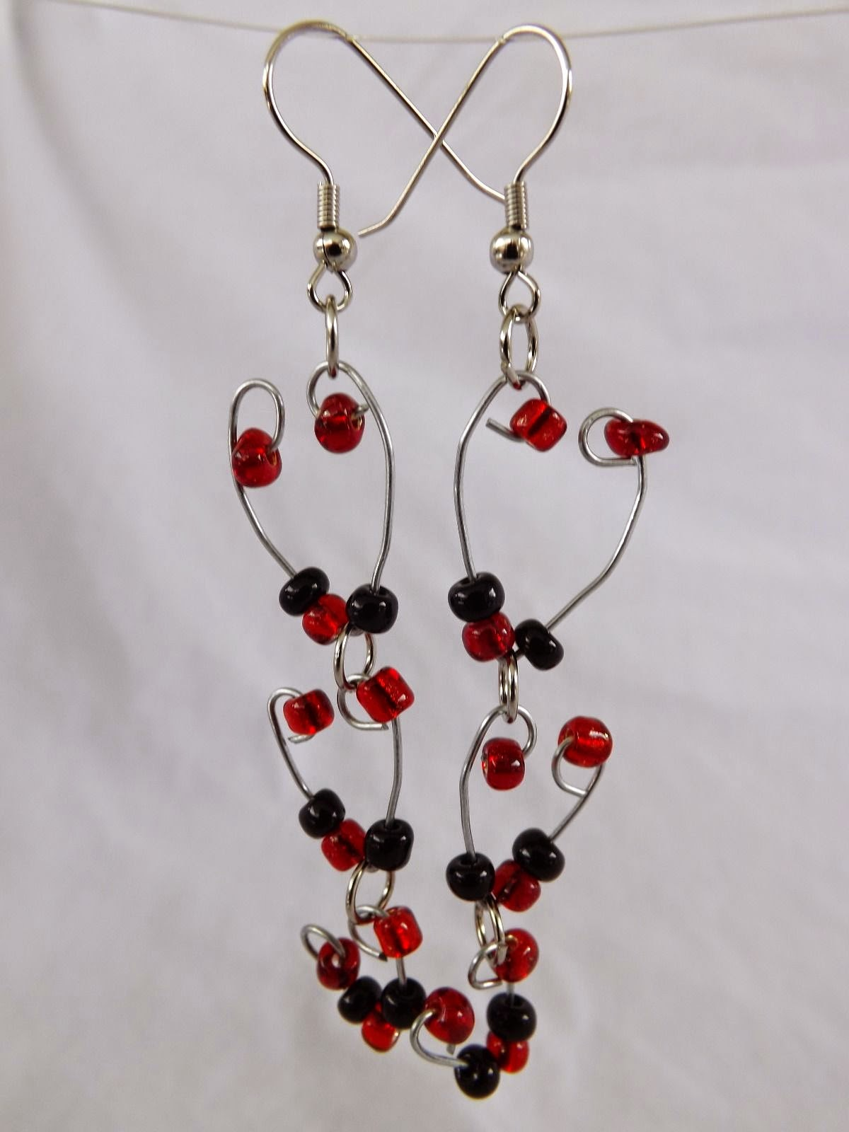 http://www.ebay.com/itm/Decending-Heart-Earrings-Handmade-glass-dangle-with-stainless-steel-hook-/261770352940?fb_action_ids=318219618366541&fb_action_types=og.shares&fb_source=other_multiline&action_object_map=%5B857778784264377%5D&action_type_map=%5B%22og.shares%22%5D&action_ref_map=%5B%5D