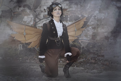Steampunk lady with goggles and wooden wings