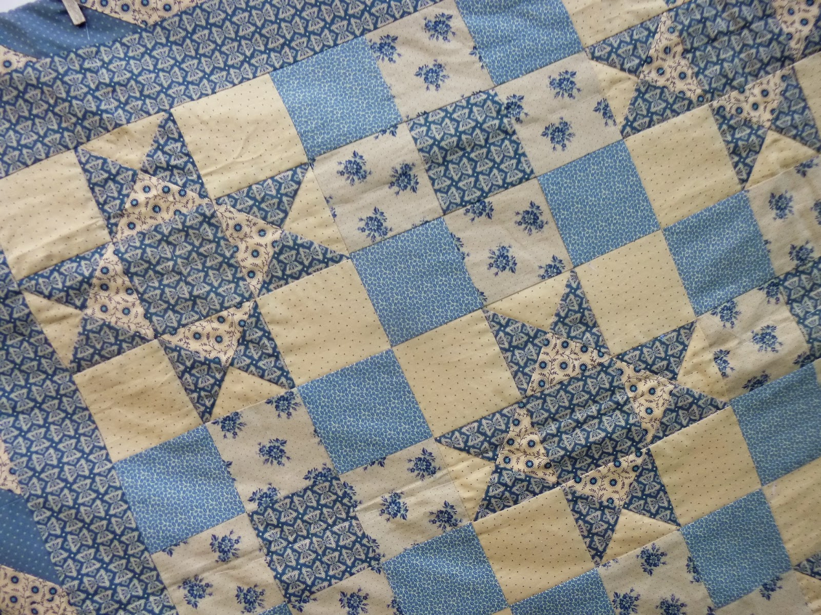 close up of Gettysburg Ohio Star quilt in blue and tan prints