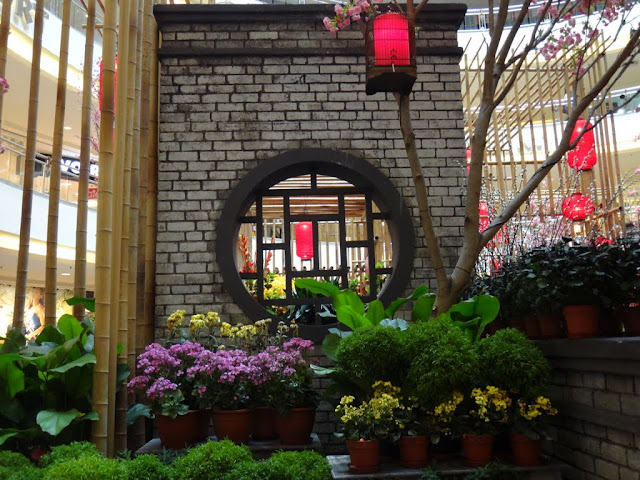 The side view of Chinese New Year mall decoration plants such as Chrysanthemum and Impatiens pots at Mid Valley Mall in Kuala Lumpur, Malaysia
