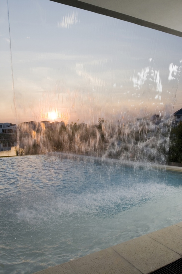 Sunset behind a waterfall