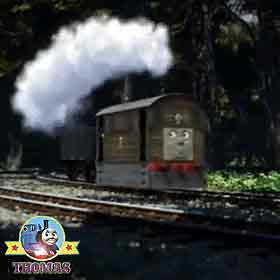 Toby the tank engine in the Whistling Woods railway track blocked with a fallen woodland pine tree