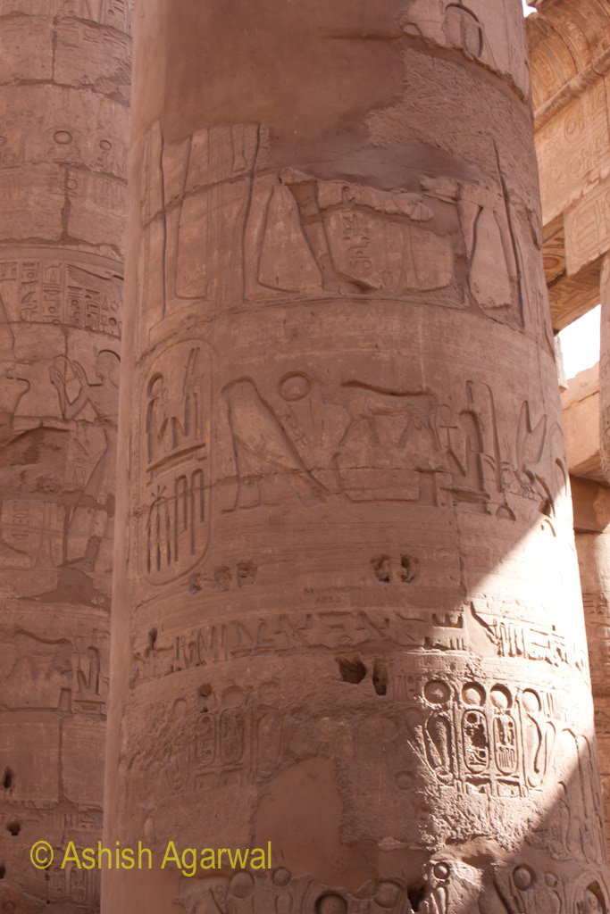 Carvings on a pillar inside the Hypostyle Hall in Karnak temple in Luxor