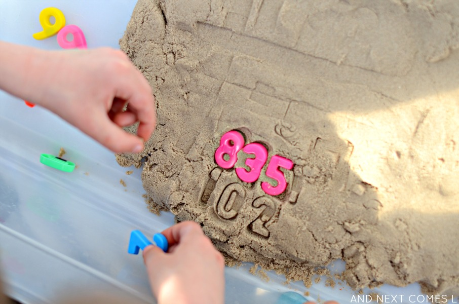Stamping numbers in kinetic sand from And Next Comes L