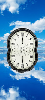 Time is now, Clock in the clouds, Reflected clock and clouds in the water
