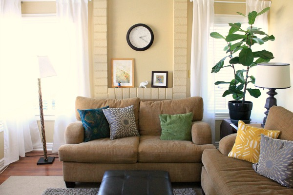 eclectic modern living room. Ikea vivan curtains, fiddle leaf fig, world market pillows.