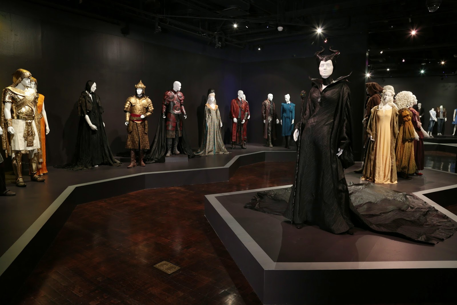 23rd Annual Art of Motion Picture Costume Design Exhibition (with the  Maleficent  Angelina Jolie costume in the forefront--FIDM Museum u0026 Galleries & FIDM.....23rd Annual Art of Motion Picture Costume Design Exhibition ...