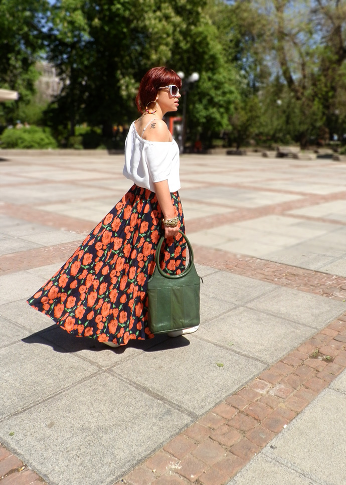 Outfit I am wearing: handmade floral maxi skirt and a white loose top paired with white ballerina flats and a handmade green leather purse in a bohemian outfit