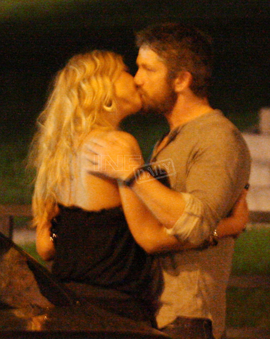 Gerard Butler lets it all hang out as he cosies up to girlfriend on LA ...