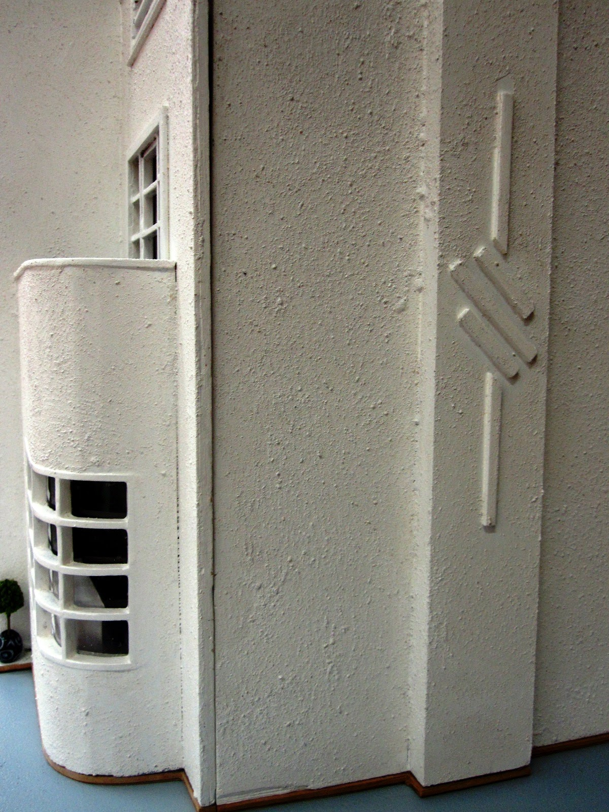 Side view of an Art Deco moderne-style dolls house by Anne Reid