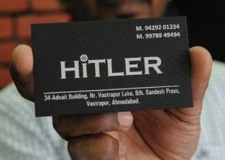 A business card displaying the Hitler clothing store details