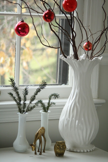 white vase with curly willow and red christmas glass balls, simple and elegant