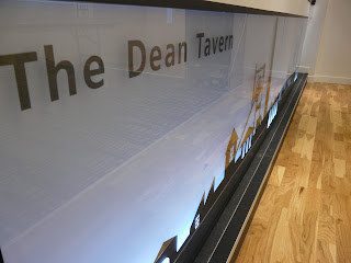back-lit perspex bar front with graphic. bar refurbishment, Function room, refurbished back-lit bar at Dean Tavern by cb3 design architects Bar shows back lit graphic,