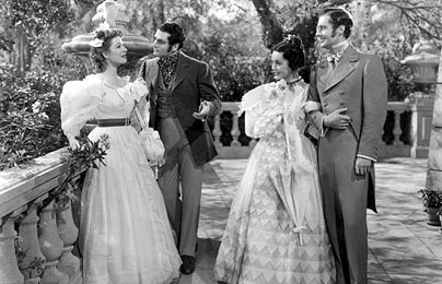 Elizabeth and Darcy and Jane and Bingley from the black-and-white Pride and Prejudice with Greer Garson and Laurence Olivier. All wear very Victorian clothes.