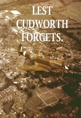 A sepia book cover, showing a Spitfire flying over Cudworth.  The caption is Lest Cudworth Forgets.