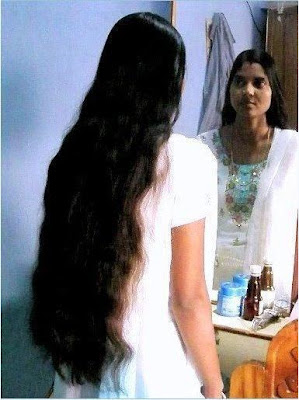Mallu long hair girl making over before her dressing table.