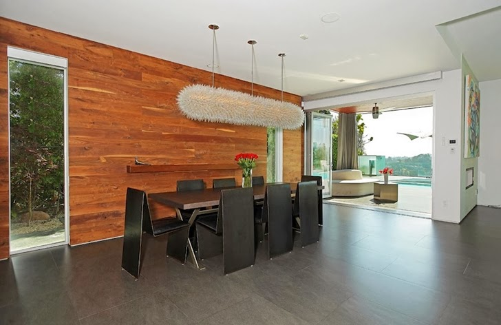 Dining room furniture in Modern Beverly Hills House with open interiors