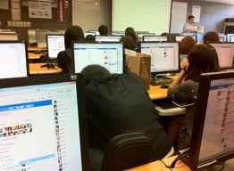 Students on facebook in class.
