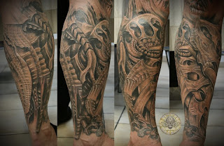 3d tattoo on the leg: alien-like bones and tissues