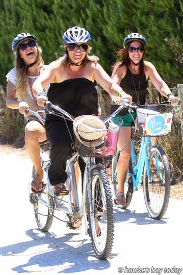L-R: Olga Lyubova, Katy Clark, Mt Maunganui, Lindsay Freeman, Katikati, cycling along Ngatarawa Rd, Bridge Pa - eight wineries involved in the first one-day annual Bridge Pa Wine Festival. photograph