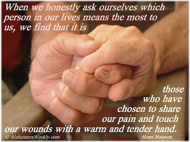 "2 adult hands holding each other, with the saying, ""The ones who mean the most to us are those who share our pain and touch our wounds with a warm and tender hand."""