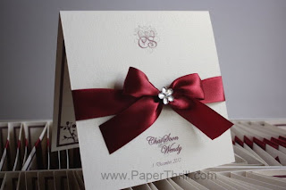 Red ribbon wedding invitation card