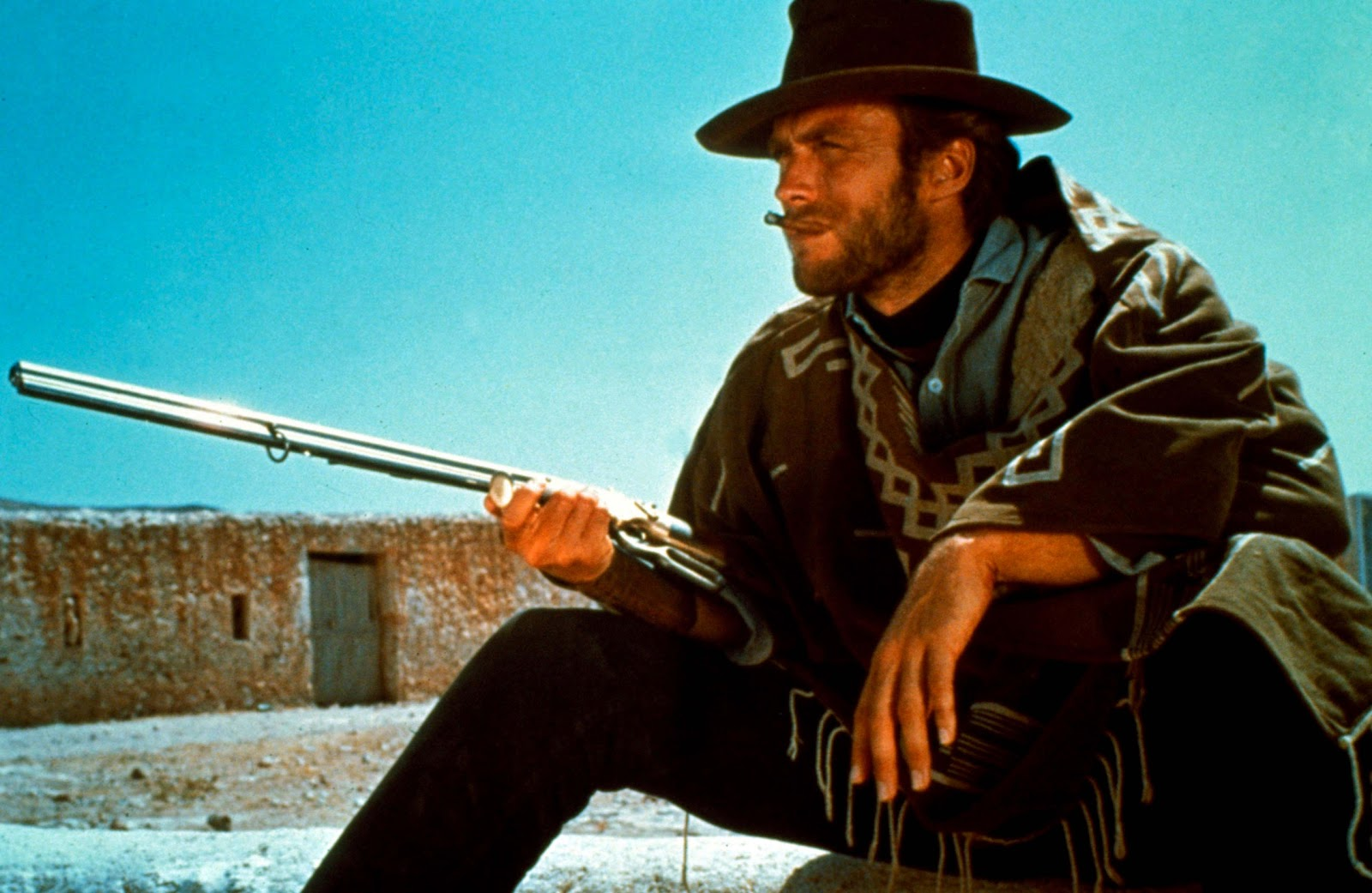 http://1.bp.blogspot.com/-bhozQxyaNAY/TnZnsAq58XI/AAAAAAAADH0/jEkBv3PIkiA/s1600/Clint_Eastwood_Holding_Rifle_Cowboy_HD_Wallpaper_Vvallpaper.NET.jpg