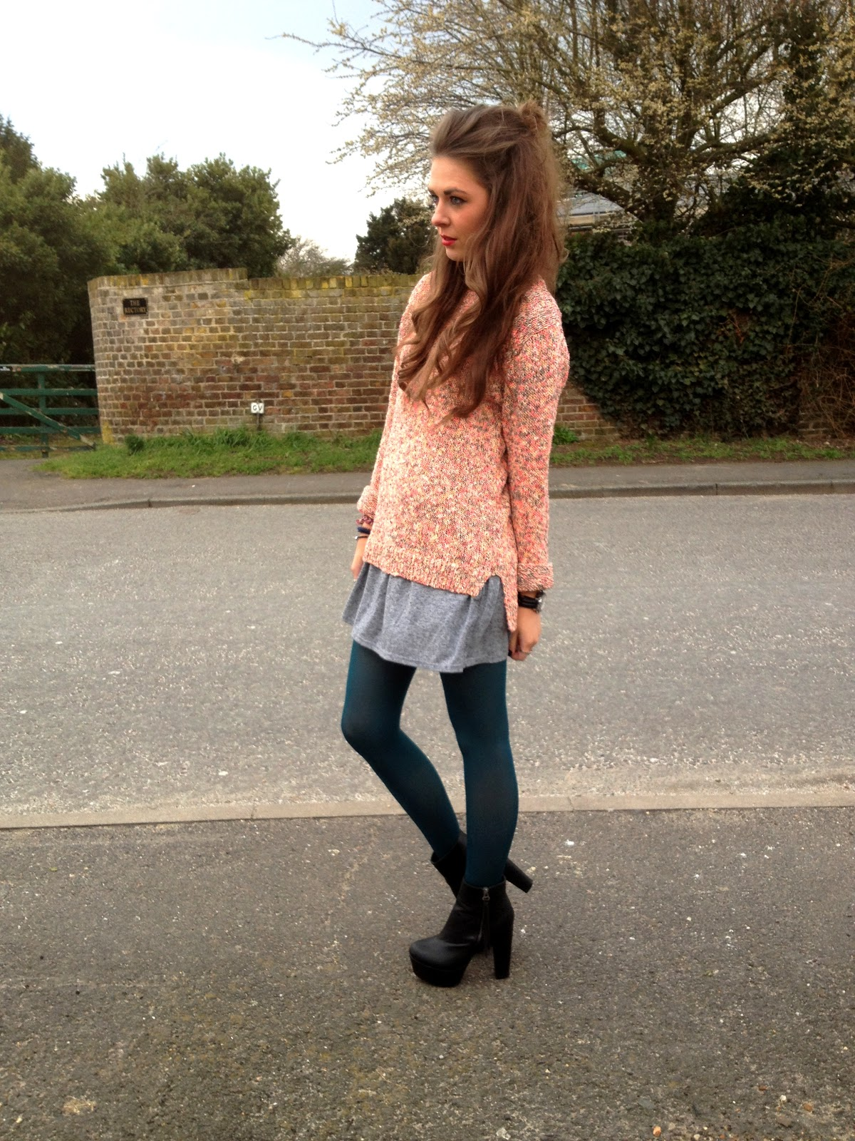 Fashion blogger wearing NEXT jumper and topshop dress with green tights