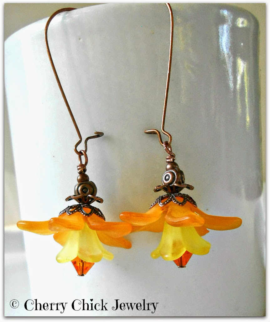http://www.cherrychickjewelry.com/product/lucite-flower-earrings-orange-dangle-sunshine-yellow-spring