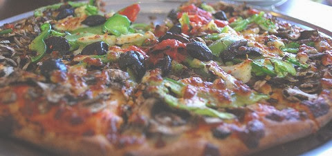 Spicy Vegan Pizza with Mushrooms Olives and Capsicum