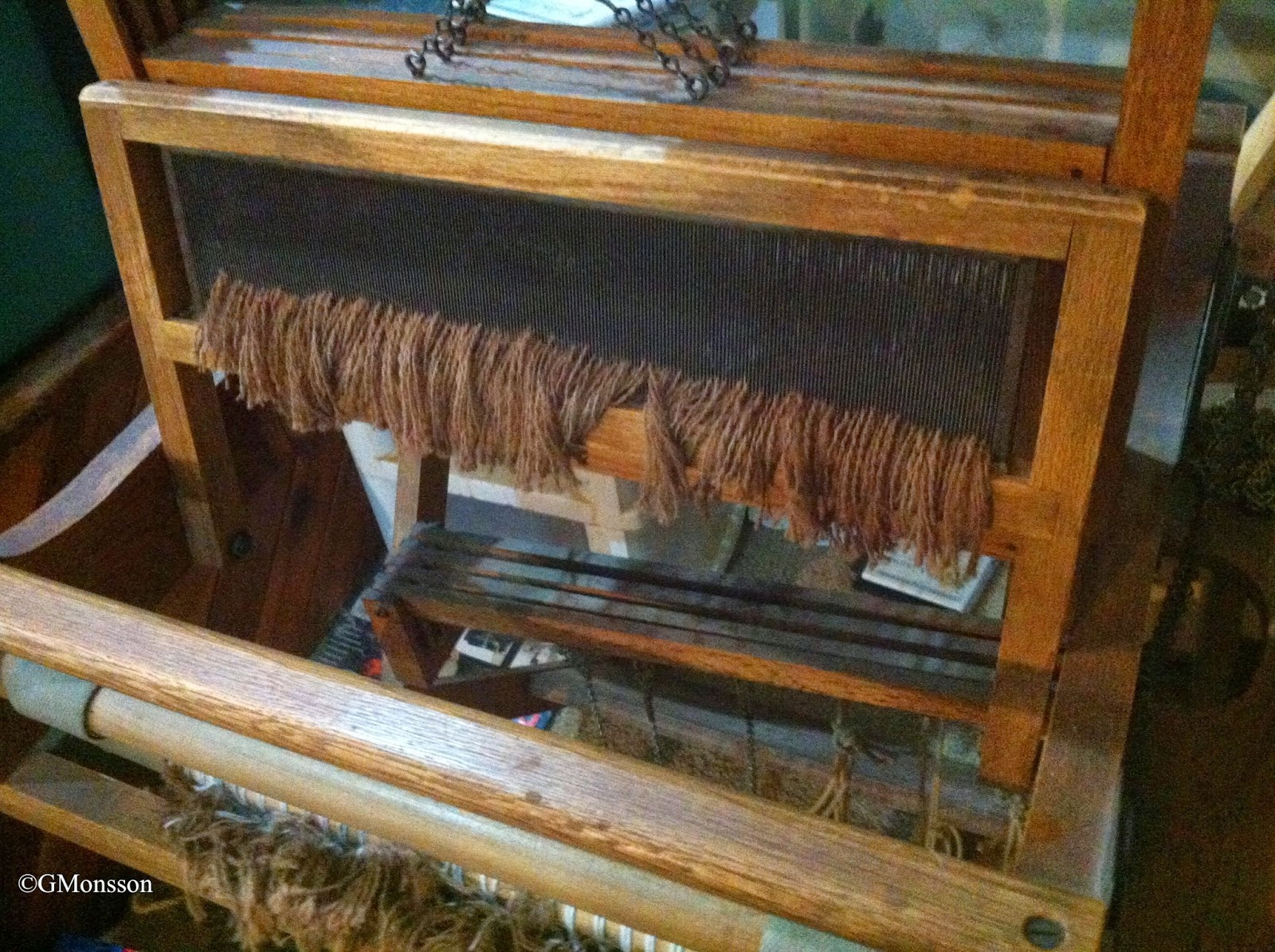 brown thrums hanging on the loom