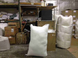 large bag of polyester stuffing before shipping opr packing
