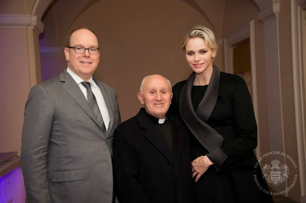 Prince Albert and Princess Charlene stepped out on the balcony to take part in this Holy Week tradition.