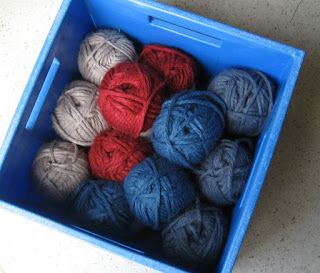 Top view of blue crate full of bulky weight yarn
