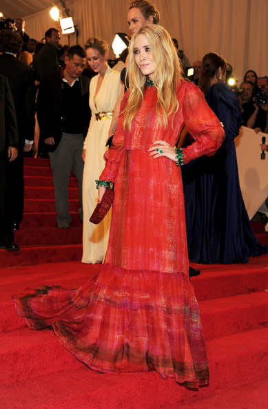Mary-Kate Olsen in a red and green vintage Givenchy Haute Couture gown at the 2011 MET Gala.