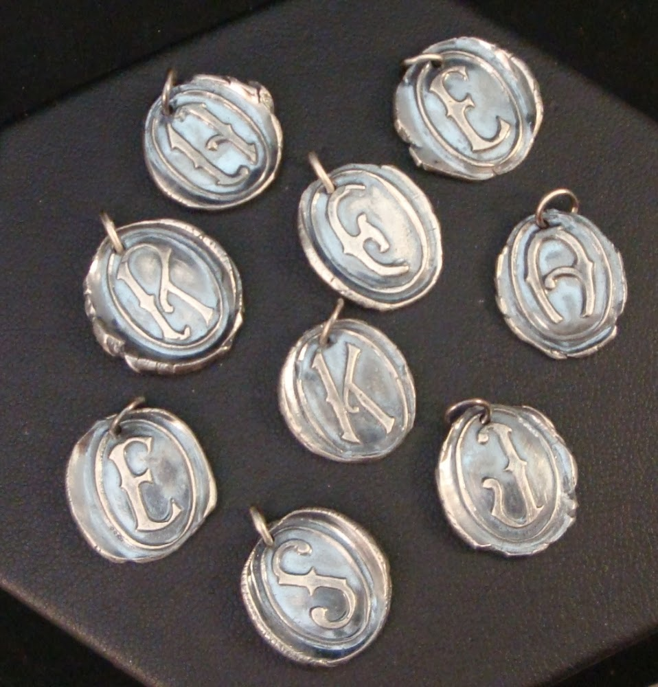 http://www.crowstealsfire.com/product/oval-initial-necklace-victorian-wax-seals