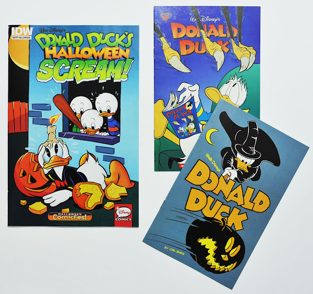 """Donald Ducks's Halloween Scream!"" compared to earlier giveaways from Gemstone and Fantagraphics."