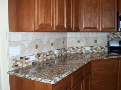 a verde butterfly granite countertop with a santa cecilia granite countertop island. This homeowner also selected a custom tile backsplash design