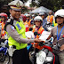 Satlantas Polres Gresik Sosialisasikan Millennial Road Safety Festival Kepada Wajib Pajak dan Pemohon SIM